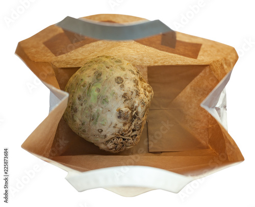 celery root in a paper bag isolated