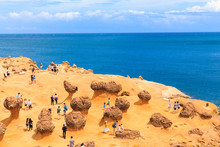 YEHLIU,TAIWAN-AUGUST 22,2017: Many Tourists Watch The Stone Strange Shape At Yehliu Geopark,These Rock Caused By The Erosion Of Sea Waves