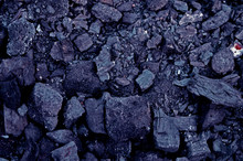 Texture Of Burnt Coal In A Fire. Tinted Dark Blue Background