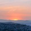 Beautiful warm sunset over mountain silhouettea¿s