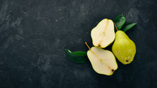 Fresh Pears On A Black Stone Table. Fruits. Free Space For Text. Top View.