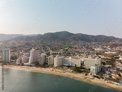 Fotografie, Obraz  Aerial panoramic view of the Acapulco Bay in Mexico during the sunset