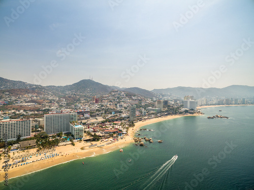 Fotografia, Obraz Aerial panoramic view of the Acapulco Bay in Mexico during the sunset
