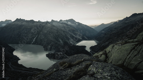 Foto op Plexiglas Grijze traf. Mountainous panorma landscape view with big mountains. Mountain Pass in Switzerland. Autumn mood at Grimsel Pass. The pass road runs through a wild