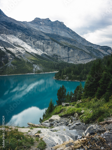 Poster Bergen Beautiful blue natural lake oeschinensee, in Switzerland, a fantastic mountain landscape overlooking the water and forest, Sport