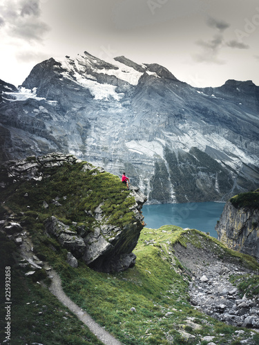 In de dag Groen blauw Beautiful blue natural lake oeschinensee, in Switzerland, a fantastic mountain landscape overlooking the water and forest, Sport