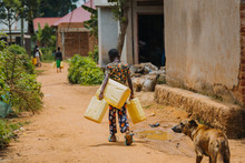 Child Carrying Water Can In Uganda, Africa