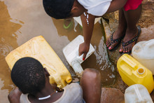 People Getting Water At A Well...
