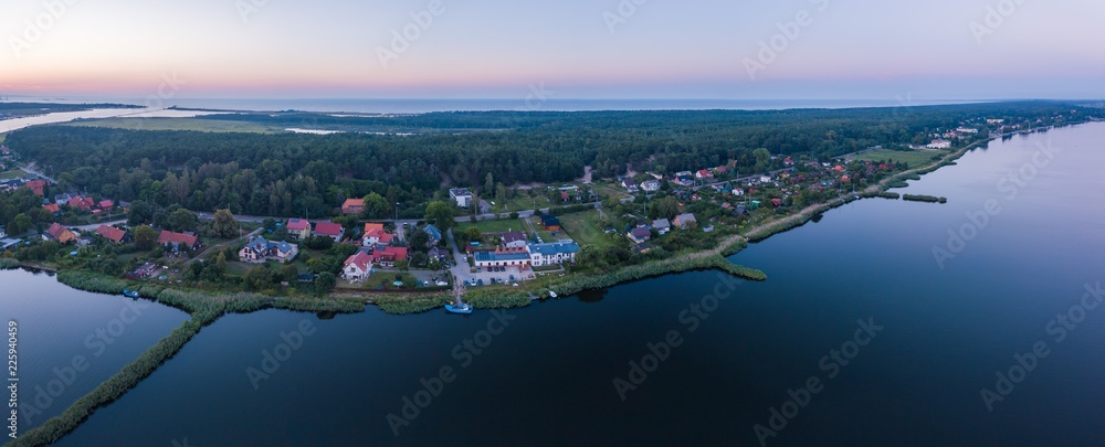 Fototapety, obrazy: Beautiful sunset over estuary of Vistula river in Gdansk. Summer sunset over sea and river and small village.