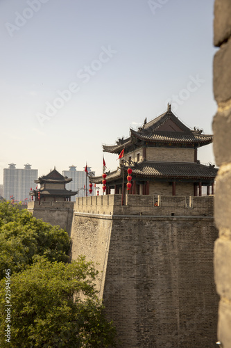 Tuinposter China Ancient dity wall with pagodas against modern Xian, China