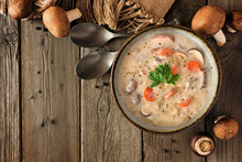 Creamy Mushroom Soup. Autumn Food Concept. Above View Scene On A Rustic Wood Background With Copy Space.
