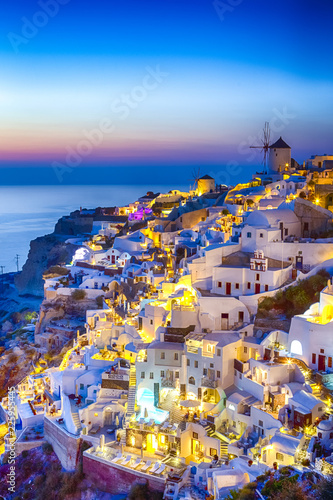 Poster de jardin Europe Méditérranéenne Travel Concepts. Skyline of Oia Town with Traditional White Architecture and Iconic Windmills in Village of Santorini in Greece.World Famous Resort.