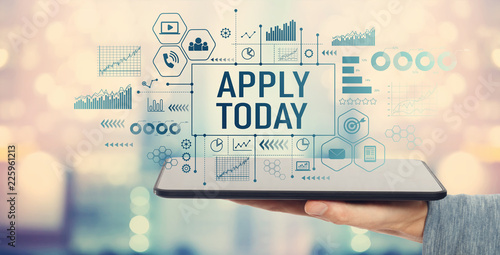 Apply today with man holding a tablet computer Wallpaper Mural
