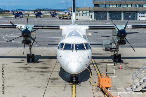 Photo  An aircraft twin turboprop parked next to a jetway at Bergen International Airport, Norway