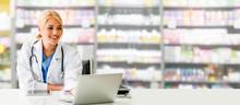 Pharmacist Using Laptop Comput...