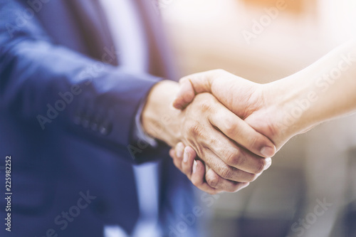 Fotografia, Obraz Concept of Negotiating business and handshake Gesturing People Connection Deal