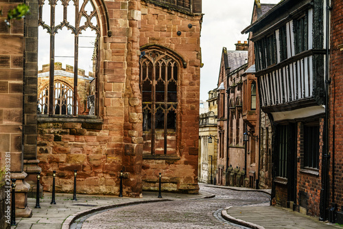 Valokuvatapetti Old English Architecture street in Coventry, destroyed Cathedral from Second Wor