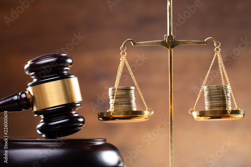 Fototapeta Close-up Of Gavel And Stacked Coins On Justice Scale obraz