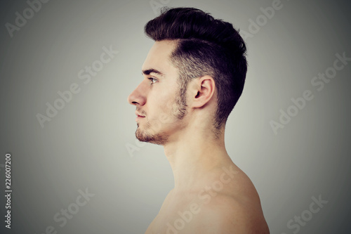 Fotografija  Profile of adult fit man