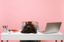 Young Frustrated Exhausted Woman Laid Her Head Down On The Table Sit Work At White Desk With Contemporary Pc Laptop Isolated On Pastel Pink Background. Achievement Business Career Concept. Copy Space.