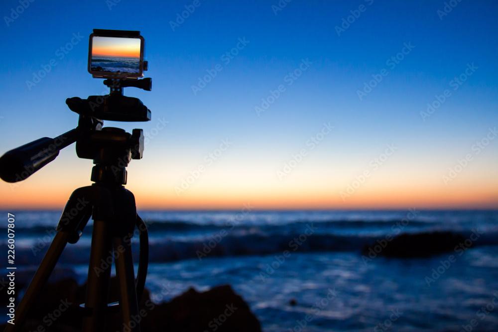 "Fotografie, Obraz  Action camera capturing a sunrise on ""Las Rotas"" beach in Denia, Spain"