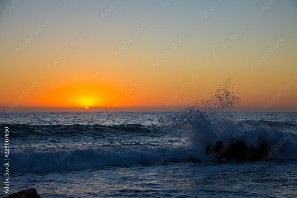 "Fotografie, Obraz  Sunrise on ""Las Rotas"" beach in Denia, Spain, Ibiza in the background"
