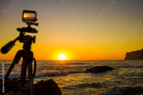 "Photo  Action camera capturing a sunrise on ""Las Rotas"" beach in Denia, Spain"