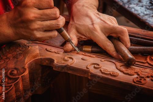 Photo  Carving and polishing of mahogany furniture