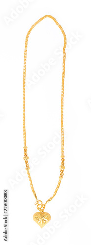 Foto Golden necklace with heart pendant isolated on white background
