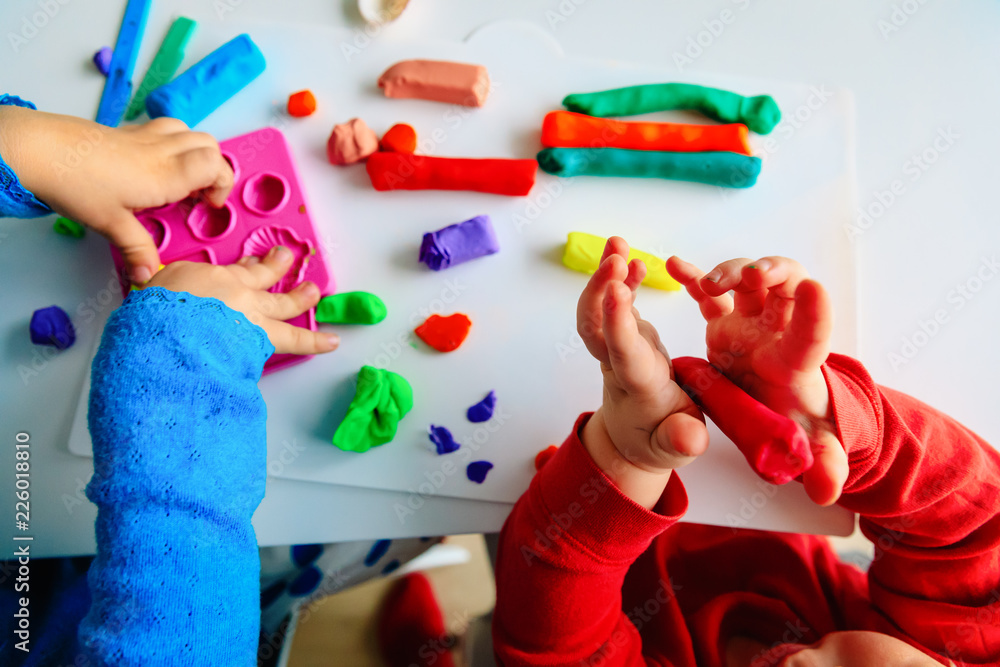 Fototapety, obrazy: kids play with clay molding shapes, learning through play