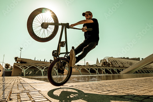 Leinwand Poster Guy riding a bmx bike .Extreme street sport