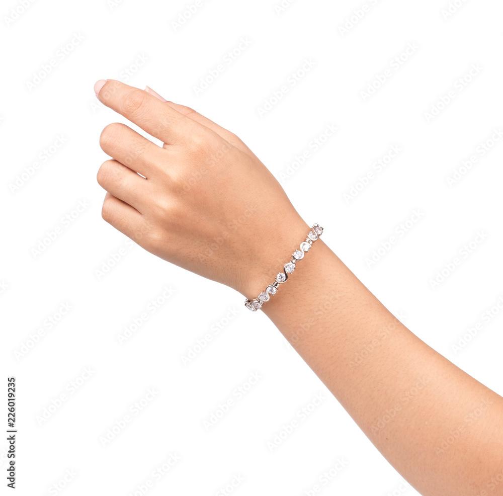 Fotografia bracelet inlaid with gemstones on hand isolated on white background