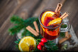 Hot tea or wine with spices, winter drink for christmas