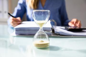 Obraz na Plexi Close-up Of A Hourglass On Desk