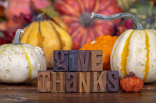 Give Thanks Text On A Colorful Background Ao Autumn Squash