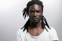 African American Male With Dreadlocks On White Background Looking At Camera
