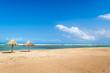 Beach umbrellas made of palm leaves on the seashore