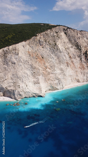 Foto op Plexiglas Nachtblauw Aerial drone photo of popular tropical paradise deep turquoise beach of Porto Katsiki with white steep rocky seascape and beautiful cloudy landscape, Lefkada island, Ionian, Greece