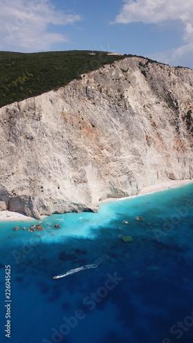 Aerial drone photo of popular tropical paradise deep turquoise beach of Porto Katsiki with white steep rocky seascape and beautiful cloudy landscape, Lefkada island, Ionian, Greece