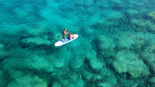 Aerial Drone Photo Of Couple Practicing Stand Up Paddle Or SUP In Tropical Exotic Emerald And Sapphire Island Sea