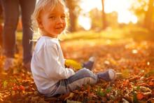Child Boy In Autumn Park. The ...