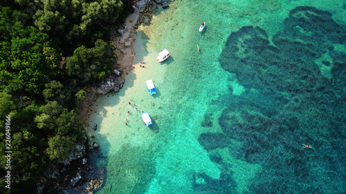 Aerial photo of iconic white cliff tropical bay forming a blue lagoon with deep Wallpaper Mural