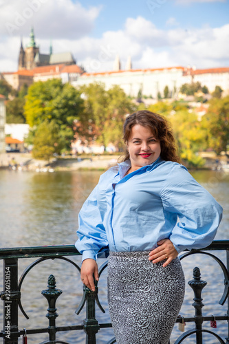 Portrait of young woman Old Town of Prague and river Vltava background in sunny Canvas Print