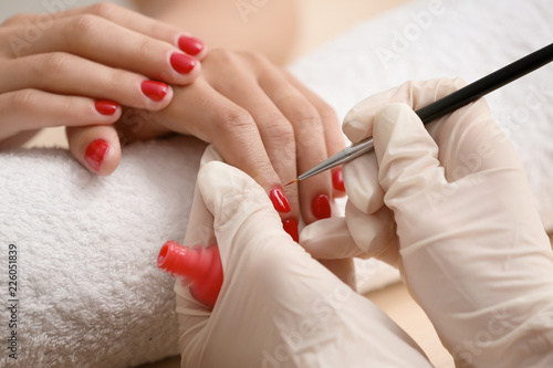 Manicure Young woman getting professional manicure in beauty salon, closeup