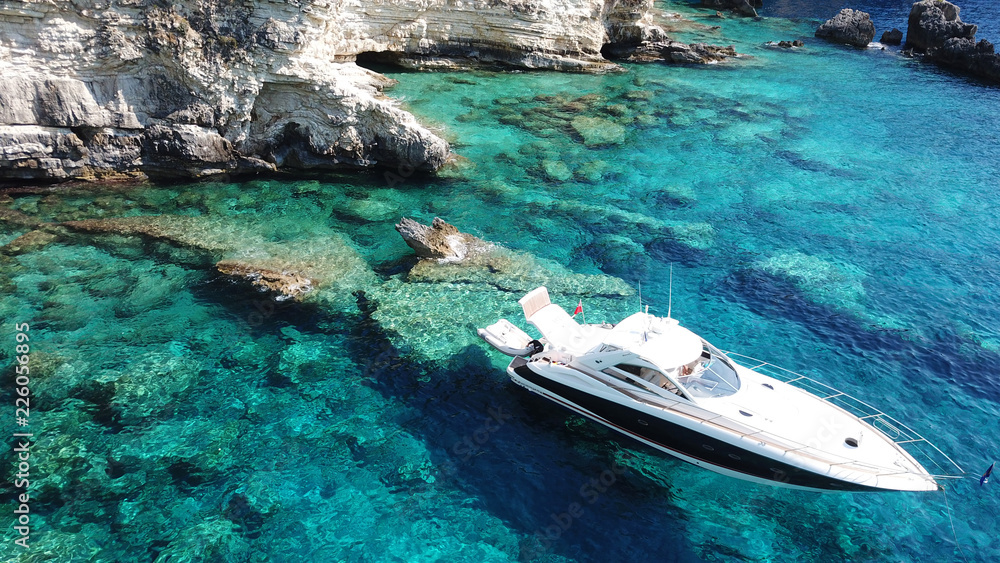Fototapety, obrazy: Aerial drone bird's eye view photo of iconic tropical rocky paradise bay called blue lagoon with caves and turquoise clear waters visited by sail boats, island of Paxos, Ionian, Greece