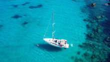 Aerial Drone Top View Photo Of Luxury Sail Boats Docked In Tropical Bay With Turquoise And Emerald Clear Sea