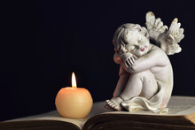 Memorial Candle And Angel Figurine