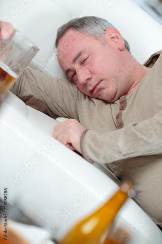 Fotografija  sad depressed alcoholic businessman