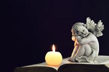 Candle And Angel Figurine