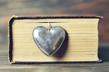 Heart Pendant And Vintage Book